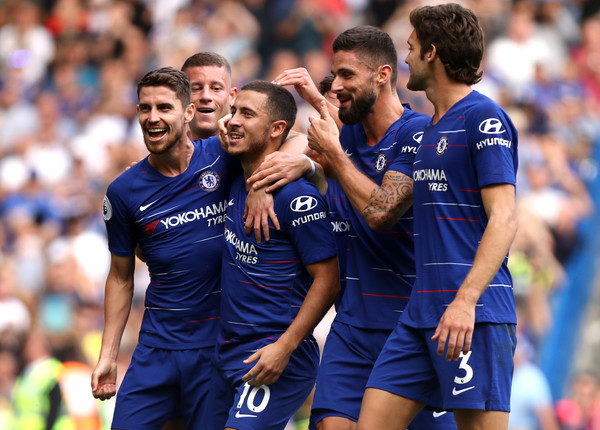 Chelsea players celebrate with their star man Eden hazard after scoring a hat-trick against Cardiff