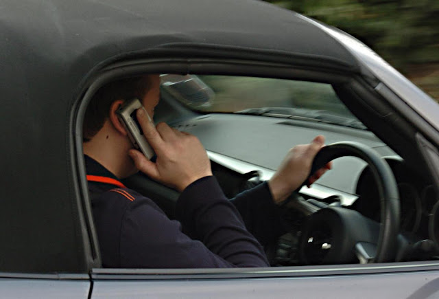 Calls for more traffic police to clamp down on drivers using mobile phones behind the wheel