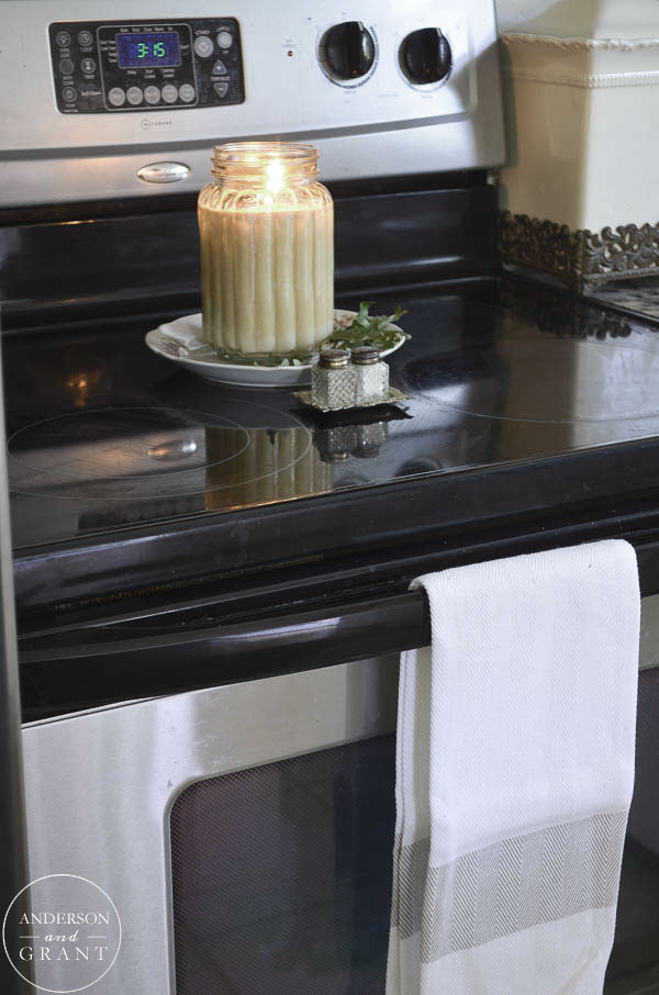 Candle burning on the stove will fill the house with a cozy fall scent.