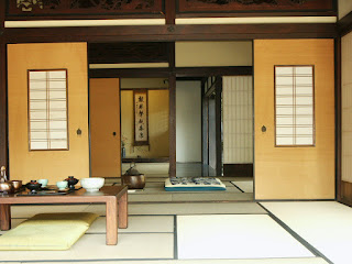 simple japanese sliding doors with wooden table and green cushions on beige area rug idea