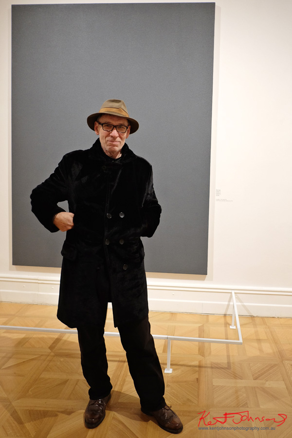 Street Fashion Prague; a man wearing a fedora hat and black velvet coat at the Richter retrospective, Prague National Gallery, Kinsky Palace. Photographed by Kent Johnson.