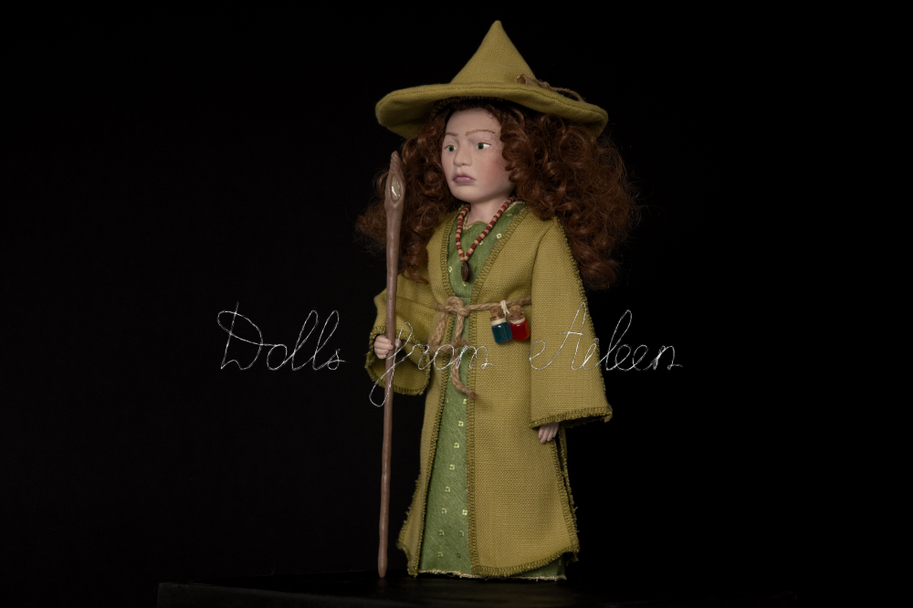 OOAK Celtic witch doll dressed in green with magic staff, view from the side
