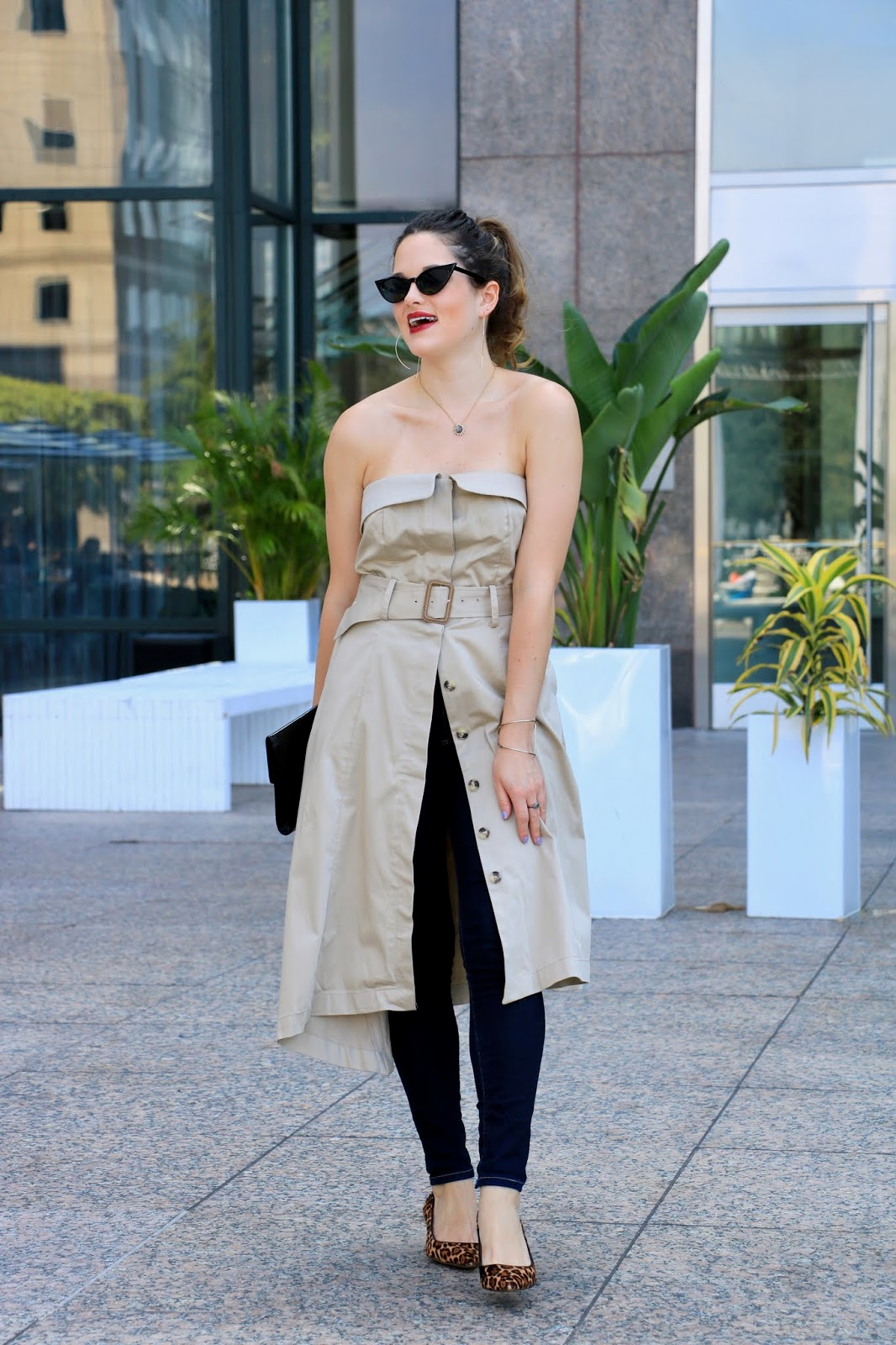 Nyc fashion blogger Kathleen Harper wearing a trench dress with jeans