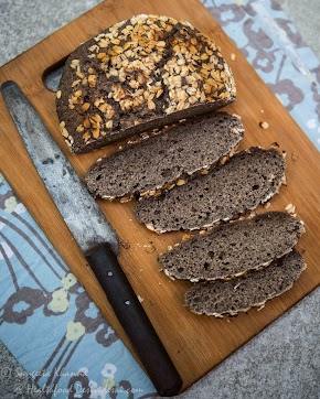 why sourdough is healthier? recipe of whole grain millet sourdough bread baked on stovetop, in a clay pot