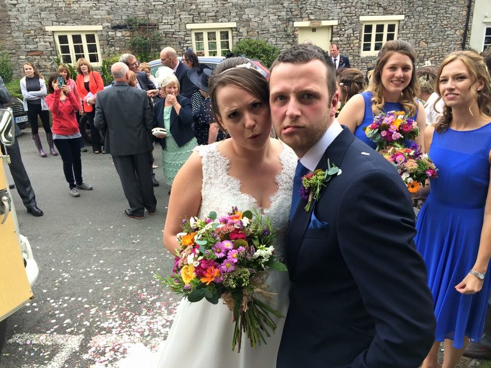 The happy couple after being showered with confettti from guests