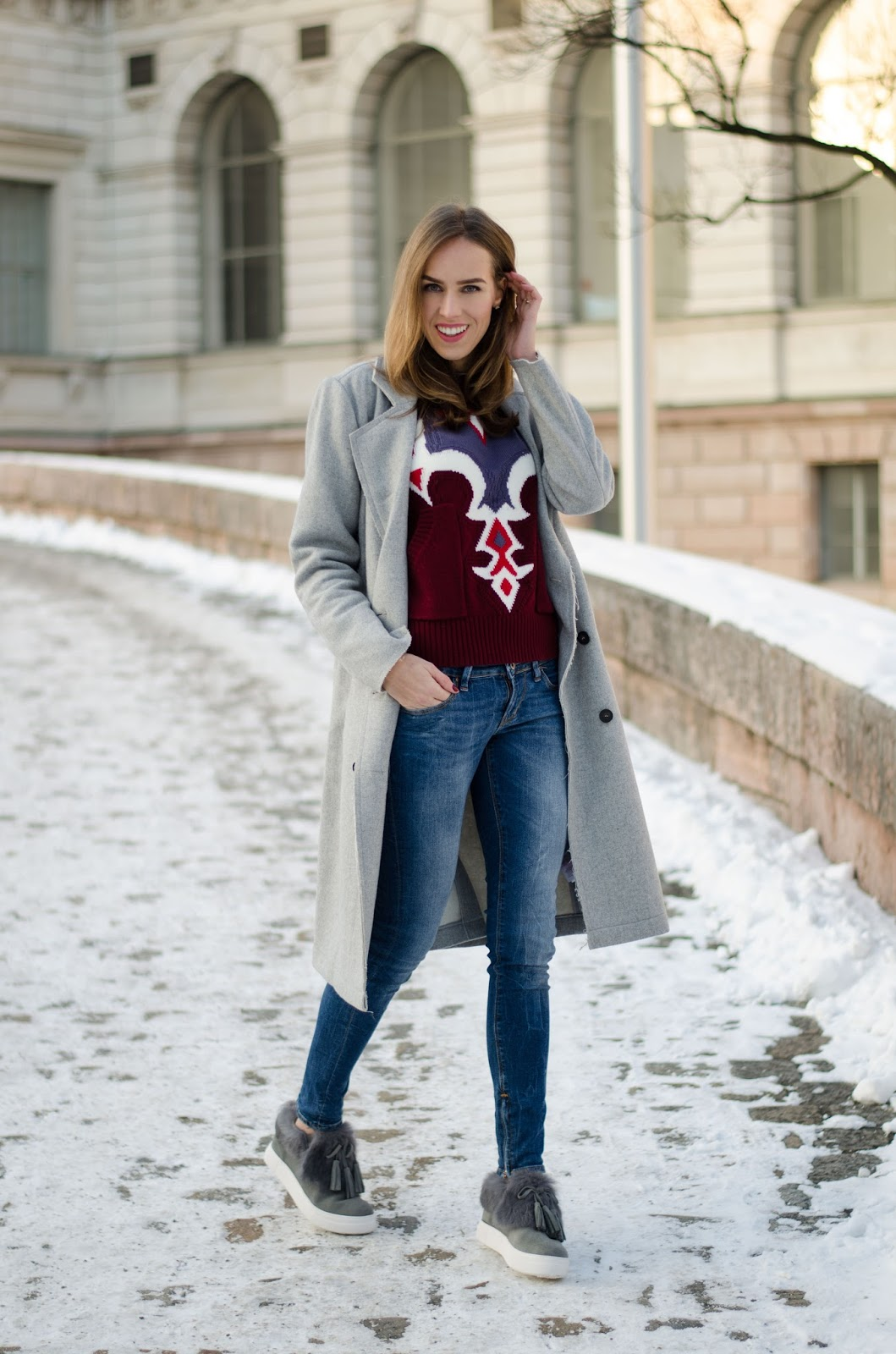 kristjaana mere gray coat bordeaux print sweater skinny jeans fur sneakers