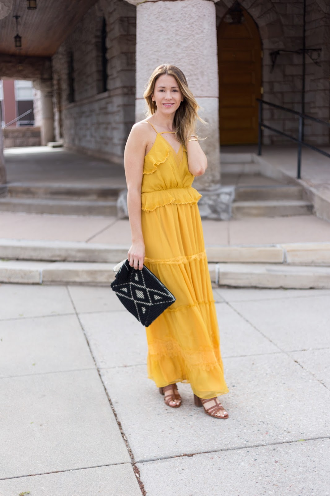 marigold maxi with black clutch