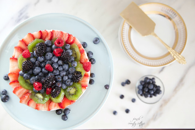 berries and kiwi on dessert cake