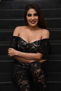 Nikki Tamboli Hot Cleavage Pics in Black Dress