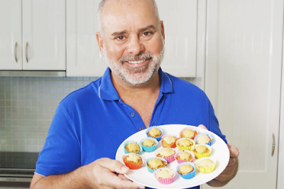 Dr Mark Perissinotto Head Veterinarian at VetShopAustralia presents a plate of pupcakes
