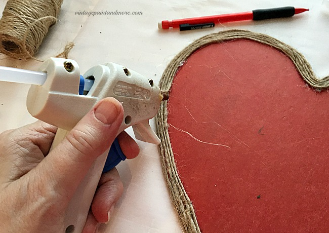 Vintage Paint and more - gluing twine on a thrift store wood heart shape for a vintage Valentine wall art