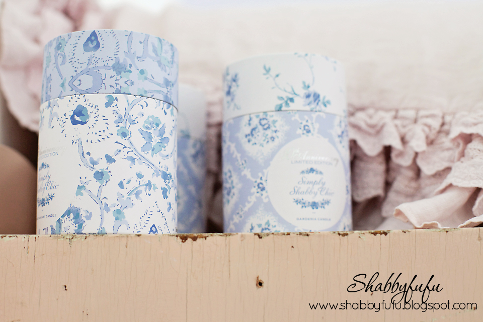 Atop out vintage pink linen cabinet are these lovely blue and white jars, alongside light pink sheets