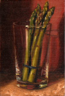 Oil painting of several asparagus spears standing upright in a cider glass.