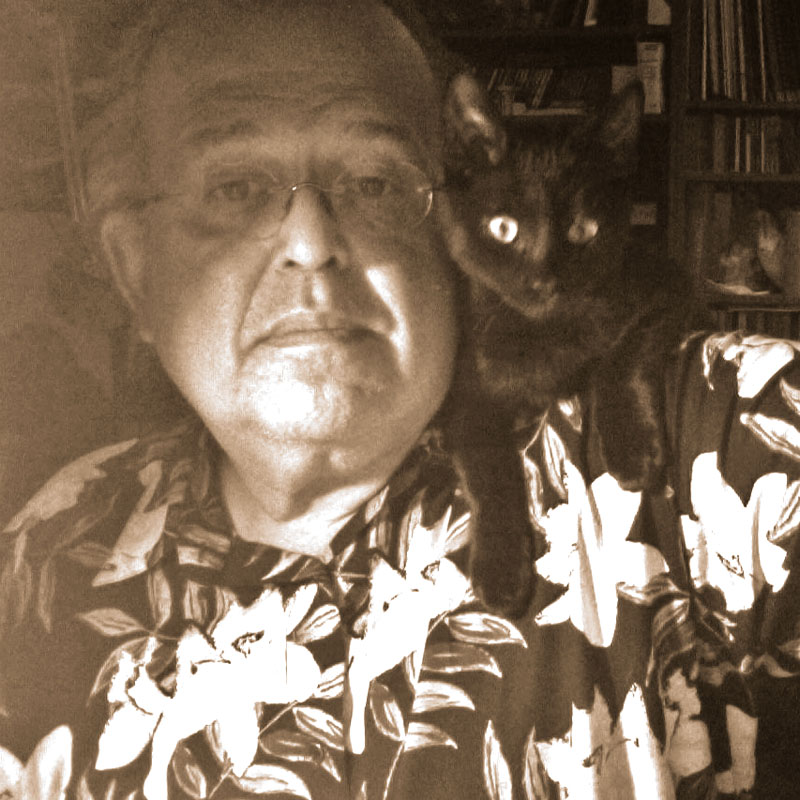 David Ocker's selfie with Doctor Pyewacket looking at the camera