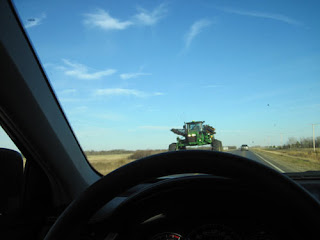 Farm Equipment On The Road.