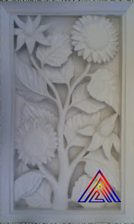 Relief batu alam paras jogja motif bunga matahari