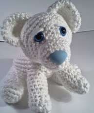 http://www.ravelry.com/patterns/library/ava-baby-polar-bear-amipal-amigurumi-stuffed-bear