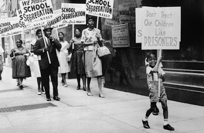 May 17, 1954, Supreme Court, under Republican Chief Justice Earl Warren, handed down the decision on the landmark case of Brown V. Board of Education.