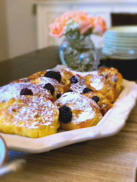 Challah French Toast Recipe, fluffy thick sliced Challah bread dipped in a creamy egg mixture until soaked through but not soggy then fried in sizzling butter.  Ideal to serve for brunch, weekend family breakfast, or like we do for weeknight dinner.