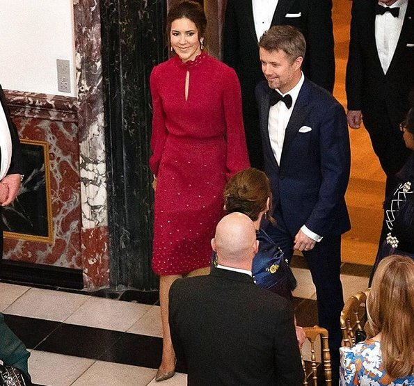 Crown Prince Frederik and Crown Princess Mary, hosted a concert a dinner in the Dome Hall. red skirt and blouse