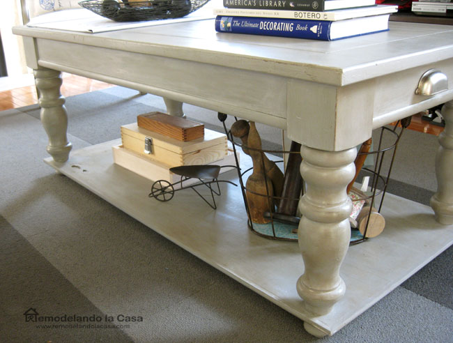 coffee table makeover - baskets - little wheel barrow and books