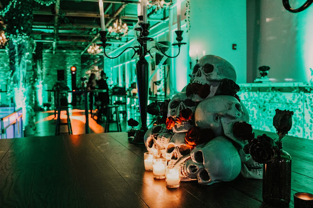 Candelabra, skull centerpiece, black roses, Halloween