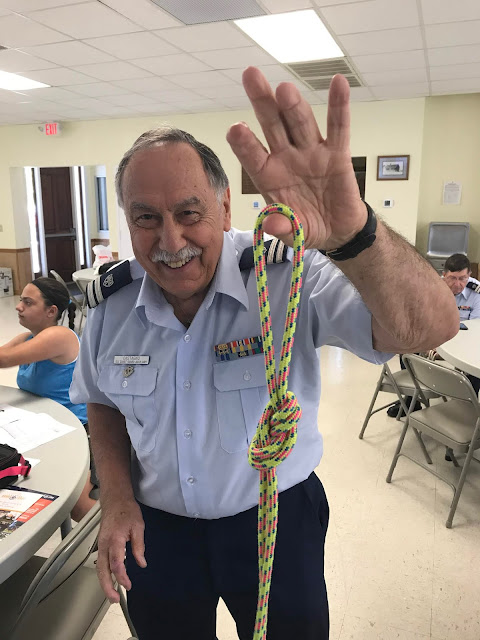 """Auxiliarist Bill Castagno shows off his knot skills with the class. """"Knot"""" a problem here!"""