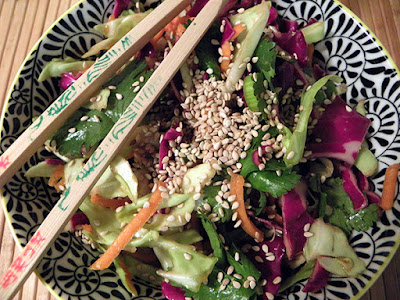 Bowl of Asian Salad with Chopsticks