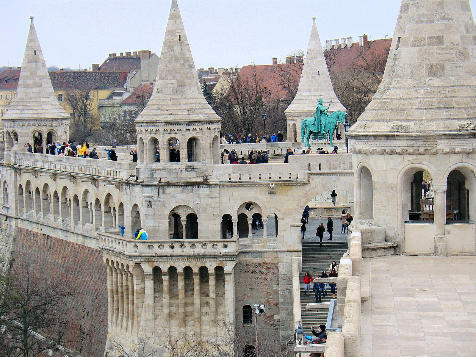 The rear view of Fisherman's Bastion reveals the old castle ramparts that served as the base for the fairy-tale structure. Note the statue of King Stephen (István).