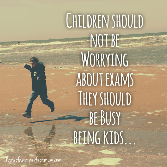 Children should not be worried about exams they should be busy being kids. (Picture of boy jumping over water on the beach.)