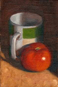 Oil painting of a tomato beside a green and white coffee mug.
