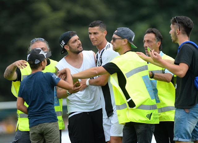 Cristiano Ronaldo mobbed after scoring on his debut game