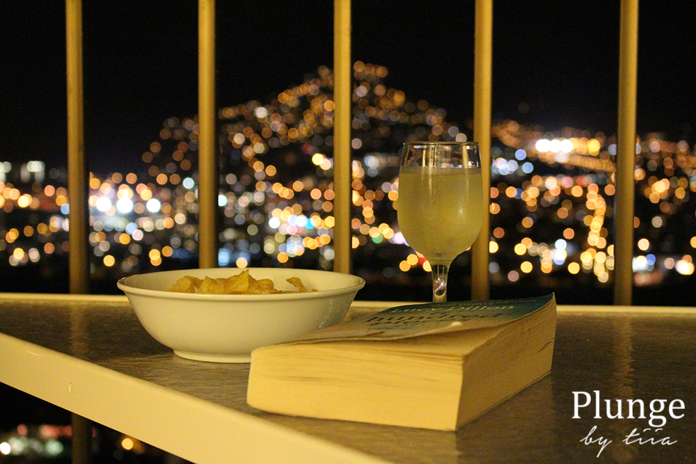 Book, wine and chips on the balcony at Aston Waikiki Sunset