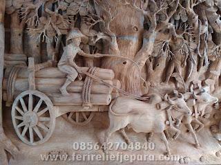ukiran relief penebangan kayu