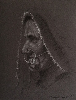 A Charcoal portrait sketching of a woman from Kutch on toned paper by Manju Panchal