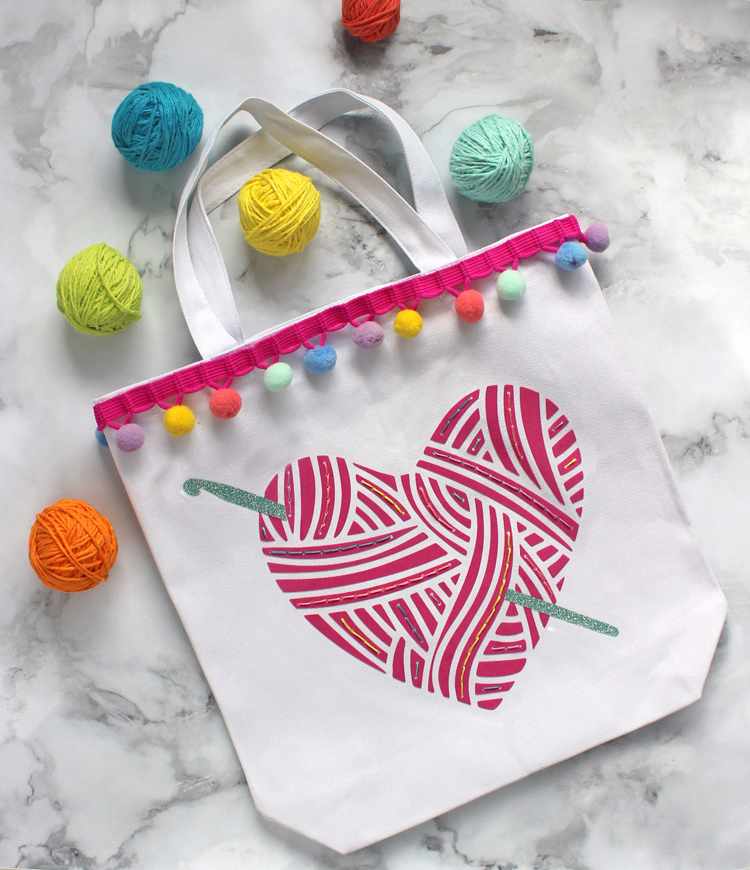 Make a custom yarn bag by combining HTV and hand embroidering