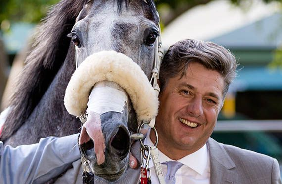 Horse racing trainer Joey Ramsden with King of Pain