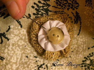 Creating a layered fabric yo-yo with button.