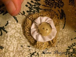 Creating a layered fabric yo-yo with button.