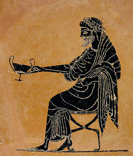 Seated Greek god Dionysos holding out a kantharos  (Greek Cup) and drinking wine.