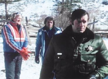 The ski resort people and the Sheriff talk things over after the first body is found.