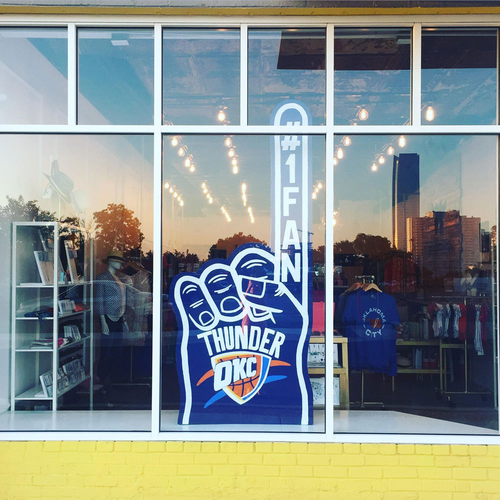 the black scintilla store front window in midtown okc