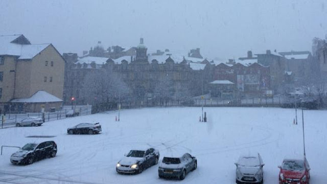 Heavy snow closes schools and causes rush hour chaos