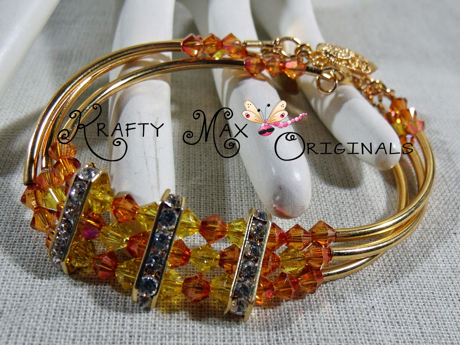 http://www.lajuliet.com/index.php/2013-01-04-15-21-51/ad/beaded,49/exclusive-golden-glow-swarovski-crystal-and-gold-plated-triple-strand-bracelet-a-krafty-max-original-design,343