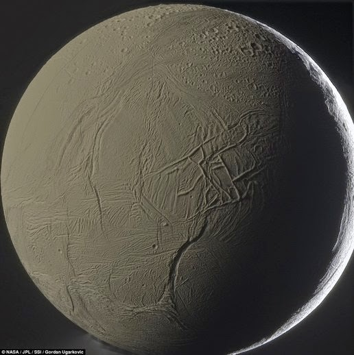 This image shows the surface of Enceladus in detail. This month is assumed to have an ocean of liquid water beneath the hard icy surface