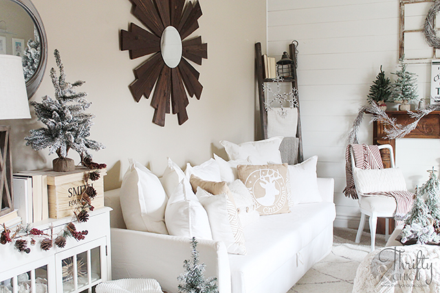 Christmas living room decor and decorating ideas. Farmhouse Christmas decor. Flocked Christmas trees. Shiplap wall and Christmas. Antique styled wood mantel. Wood mantel Christmas decor.