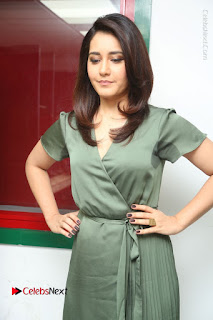 Actress Raashi Khanna Stills in Green Short Dress at Mirchi 95 Suno Aur Mercedes Jeeto Contest  0074.JPG