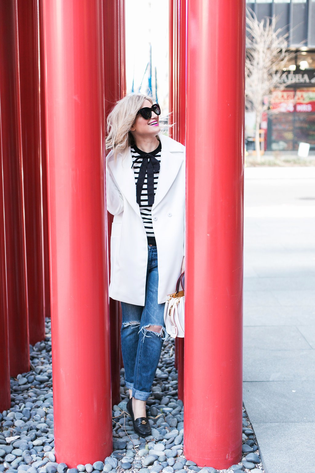 Bijuleni - White duster coat, stripe bow shirt, boyfriend distressed jeans and Coach moccasins and satchel Rogue 25