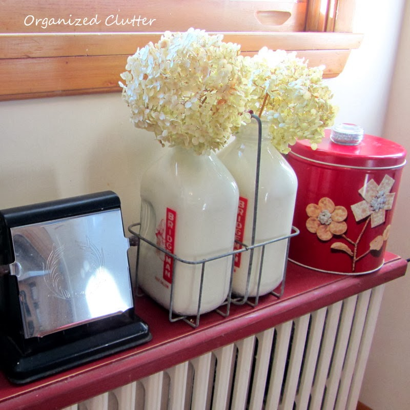 Vintage Milk Bottles & Carrier with Inside Painted with Paint www.organizedclutterqueen.blogspot.com