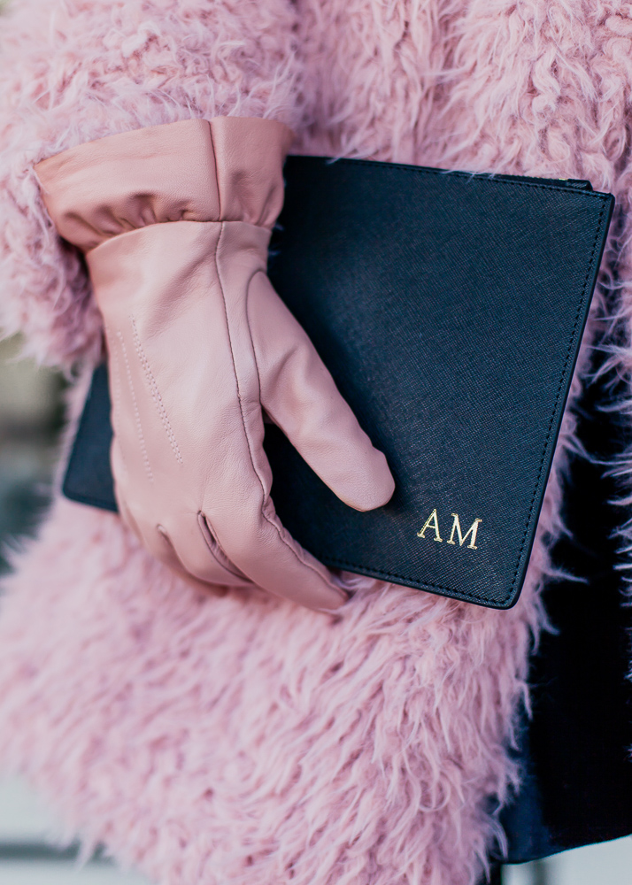 the daily edited black monogrammed pouch